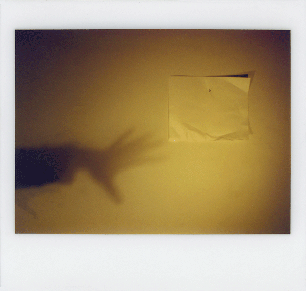 7275741730 shadow hand and paper.1